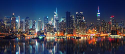 Fototapeta Panoramatické New York Manhattan v noci osvětlené